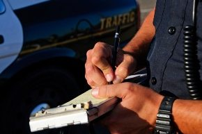 officer writing a ticket