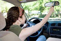 117450246_girl_adjusting_rearview_mirror