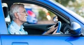 Elder man driving a car