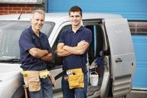 workers standing next to a van