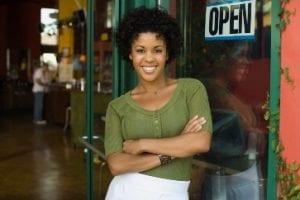 78375490 lady standing in business doorway